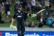 Black Caps batsman Martin Guptill acknowledges the crowd after getting his 150. Photo / Alan Gibson