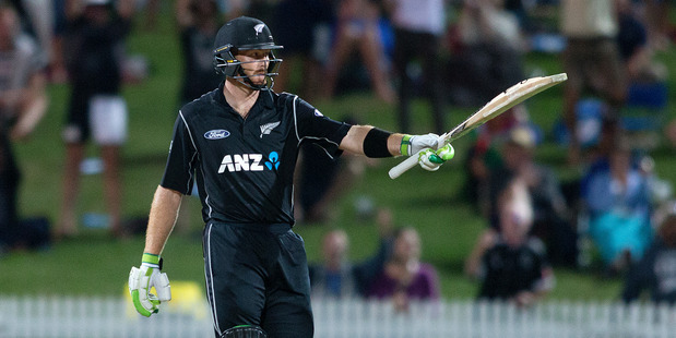 Loading Black Caps batsman Martin Guptill acknowledges the crowd after getting his 150. Photo / Alan Gibson