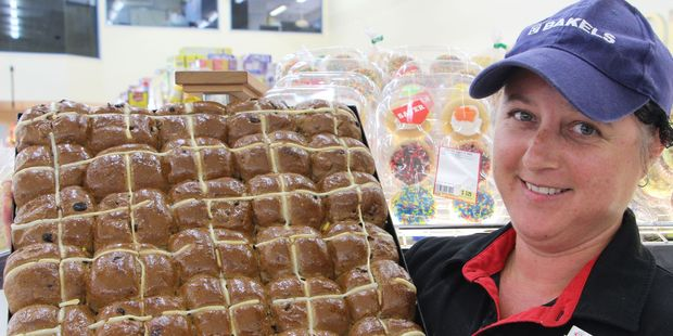 Amanda with  some of the hot cross buns being produced daily at Stratford New World.