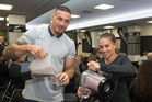Rugby stars Sonny Bill Williams and Selica Winiata pouring smoothies they made during the RugbySmart  presentation in Wellington today. Photo/Mark Mitchell