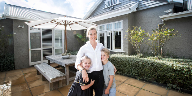 Property owner Emma Main with her children Scarlet, 5, and Henry, 7, at their new home on Mainston Road in Remuera. Photo / Jason Oxenham