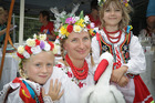 Enjoying the multicultural festival are Julia James 7, mother Magdalena James, and Leia Lawson, 6 from Poland. Photo/Andrew Warner.