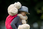 FRIENDS: Jayda Best, 8, with Fred the dog at the teddy bear's picnic in Kuirau Park on Saturday. PHOTO/STEPHEN PARKER