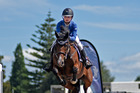Crystal Hackett clears a fence on IamwhatIam in the Pony Grand Prix at Tauranga Racecourse yesterday. Photo / George Novak