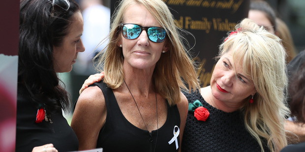 Natalie Hinton, Tara Brown's mother, with family and friends outside the Brisbane Supreme Court yesterday. Photo / News Corp