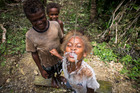 Children drink from a pipe supplying water to the village of Rarata. Photo / Mike Scott