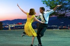 Ryan Gosling, right, and Emma Stone in a scene from, 'La La Land'. The actors and movie are front-runners in today's Academy Awards. Photo / Supplied
