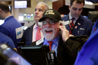 Trader Peter Tuchman wears a 'Dow 21,000' hat as he works on the floor of the New York Stock Exchange. Photo / AP