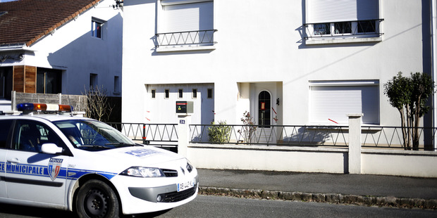 A police car parked outside the house belonging to the missing Troadec family. Photo / AP