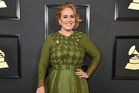 Adele's family are upset by reports the star recently wed in secret. Photo / AP