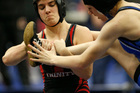 Euless Trinity's Mack Beggs, left, wrestles Grand Prairie's Kailyn Clay during the finals of the UIL Region 2-6A wrestling tournament. Photo / AP