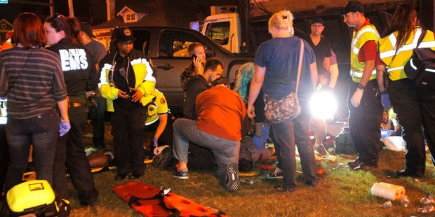 New Orleans emergency personnel attend to injured parade watchers after the truck drove into a crowd and injured at least 28 people. Photo / AP