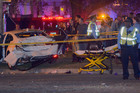 A truck ploughed into a crowd watching the Krewe of Endymion parade and injured multiple people in the Mid-City section of New Orleans. Photo / AP