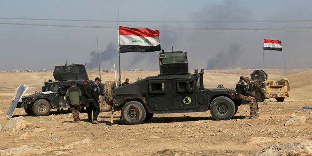 Iraqi security forces advance during fighting against Islamic State militants on the western side of Mosul, Iraq. Photo / AP