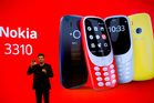 Arto Nummela, Chief Executive Officer at HMD Global, shows the new re-launched Nokia 3310 phone. Photo / AP