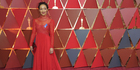 Ruth Negga in a beautiful red lace Valentino gown. Photo / AP