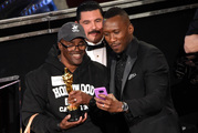 Mahershala Ali (right) takes a selfie with a tourist named Gary while holding his award for best actor in a supporting role. Photo / AP