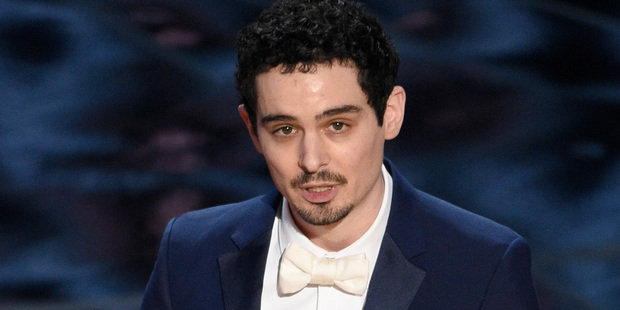 Damien Chazelle accepts the award for best director. Photo / AP