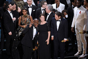 Barry Jenkins, foreground left, and the cast accept the award for best picture for Moonlight. Photo / AP