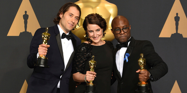 Jeremy Kleiner, Adele Romanski and Barry Jenkins, winners of the award for best picture for Moonlight. Photo / AP