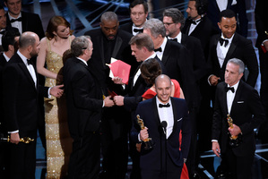 "Fred Berger, producer of ""La La Land,"" foreground center, gives his acceptance speech while the mistake is noticed by others on stage. Photo / AP"