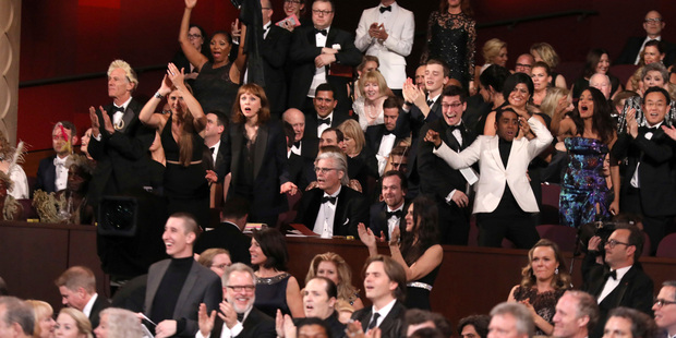 The cast of Moonlight celebrates as they win the best picture award at the Oscars. Photo / AP