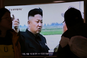 People watch a TV news program showing a file image of North Korean leader Kim Jong Un. Photo / AP