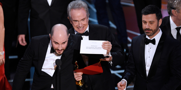 Loading Jordan Horowitz shows the envelope revealing Moonlight as the true winner of best picture at the Oscars. Photo / AP