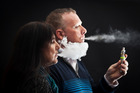 Vaping e-cigarettes. Rob and Lia Haskett opened a vaping store called Naked Vapour Shop in Papamoa. Bay of Plenty Times Photograph by Andrew Warner