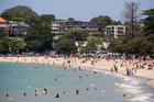 Hundreds flocked to Mission Bay to cool off as Auckland enjoyed the small heatwave in 2013. Photo / Greg Bowker