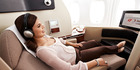 You could enjoy the luxury of a first class seat on Qantas, by purchasing air miles through partner Alaska Airlines. Photo / Supplied
