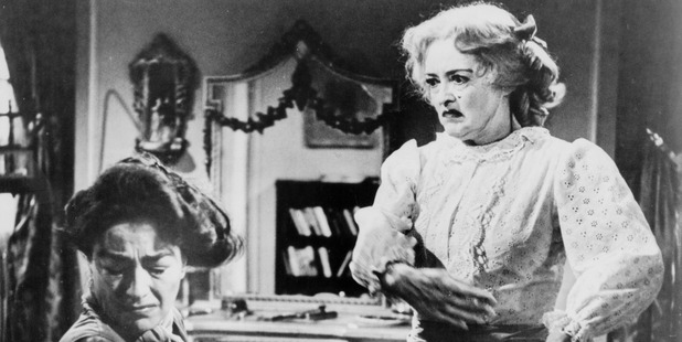 Screen legends Bette Davis and Joan Crawford face off in Robert Aldrich's unsettling 1962 melodrama, Whatever Happened to Baby Jane.