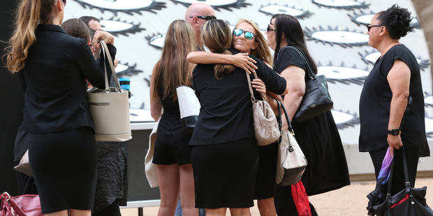 Natalie Hinton hugs supporters outside the Brisbane Supreme Court while attending the trial of Lionel Patea who has been charged with the murder of her daughter Tara Brown. Photo / Courier Mail