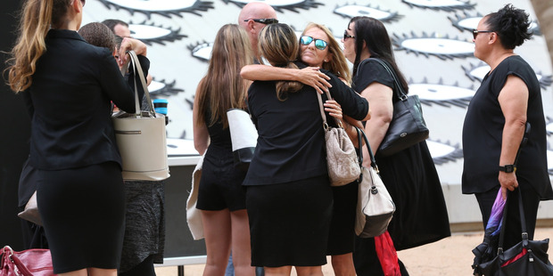 Natalie Hinton hugs supporters outside court after the trial of Lionel Patea who murdered her daughter Tara Brown.