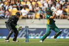 AB de Villiers of South Africa bats while Tom Latham of New Zealand looks on during game three of the One Day International series between New Zealand and South Africa. Photo / Getty Images.