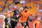 Thomas Broich of the Roar and Matthew Ridenton of the Phoenix challenge for the ball during the round 21 A-League match between the Brisbane Roar and the Phoenix. Photo / Getty Images.
