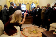 Counselor to the President Kellyanne Conway takes a picture of US President Donald Trump with members of the Historically Black Colleges and Universities. Photo / Getty Images