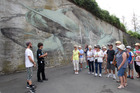 STABLE WEEK WEATHER WISE: Cinzah Merkins, Seawalls organiser and Jake Brookie, educator, National Aquarium of New Zealand led a Sea Walls Mural Tour in Napier. PHOTO/DUNCAN BROWN