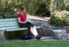 Hester Jackson-Scott  reading a book in her lunch break in the Napier Botanical Gardens enjoying a warm Hawke's Bay day. Photo/Duncan Brown