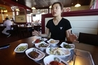 A family of three are angry at Kumkang Mountain Restaurant in Albany for their 'one person, one meal policy' on side dishes.