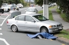 A person is dead after a car and motorbike collided on Auckland's North Shore this morning.