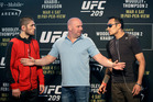 UFC president Dana White stands between fighters Tony Ferguson, right, and Khabib Nurmagomedo. Photo / AP
