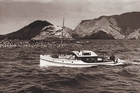 Zane Grey fishing at Bird Rock, in the Bay of Islands, in one of the two boats he had built for him - the Avalon and the Zane Grey. Both boats have been restored and are still in use. Photo / Supplied