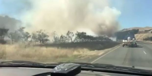Image of the fire taken from a car before traffic was halted near Hanmer Springs. Photo / via Facebook