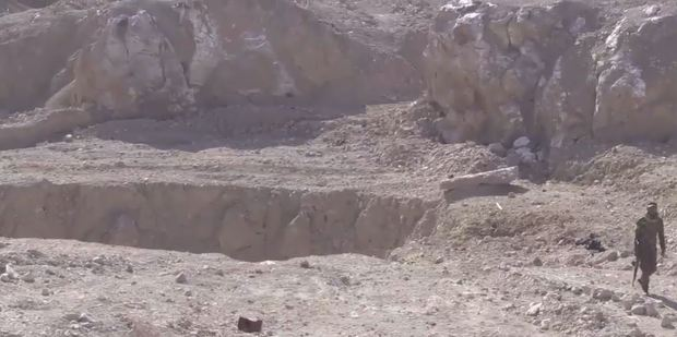 The sinkhole outside Mosul which became a mass grave.