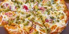 The interesting pizza topping combo: peas and mayo. Would you try it? Photo / Twitter, Air-ic