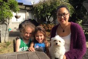 Taison, 6, Matai, 3, and their aunty Eleanor Muriwai after being reunited with their beloved pet dog Trinnie.