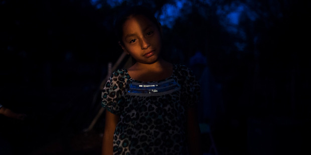 Miriam Sanchez Perez, 9, stands outside the rented trailer her family calls home in a back yard in Wimauma. Photo / Zack Wittman for The Washington Post