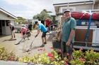 David Leigh has help to clear his property from Geoff Feisst, Karina Leigh and Jason Leigh, East Coast Rd, Kaiaua. Photo / Michael Craig