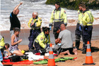 Emergency services fighting to save the life of the man who went to the rescue of children. Photo/Supplied